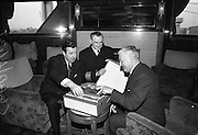 """06/04/1966<br /> 04/06/1966<br /> 06 April 1966<br /> Captain John Williams retires as Master of B & I ship the M.V. """"Munster"""". Captain Williams was presented with a tape recorder by the Masters, Officers and staff of all the B & I ships. Picture shows Captain Williams (right) trying out his presentation recorder with Captain Matthew Hollywood (centre) new Master of the M.V. """"Munster"""" and Captain Gerald Barry, Master of the M.V. """"Leinster"""" who made the presentation."""