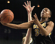 Missouri guard Tiffany Brooks drives to the basket in the first half against Kansas State, during Tigers 66-65 overtime win over K-State at Bramlage Coliseum in Manhattan, Kansas, February 1, 2006.