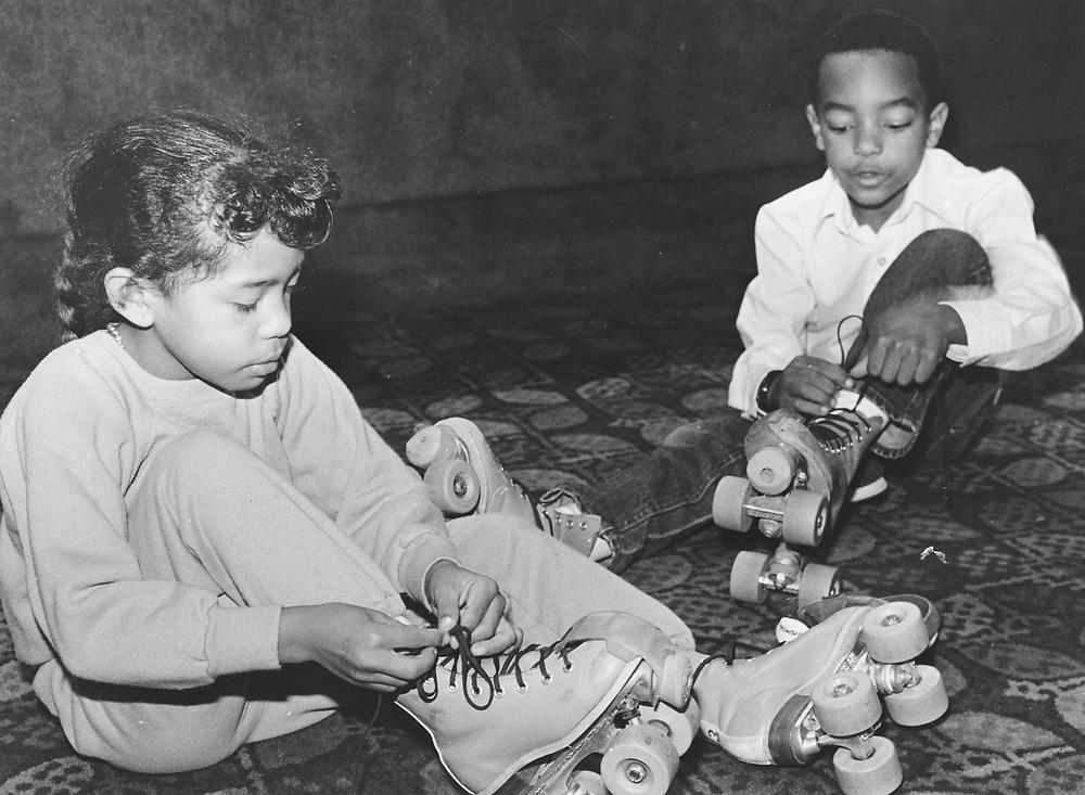 ©1985 Kids at indoor skating rink, Luling, Texas