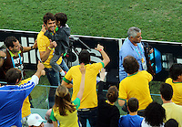 Kaka who is not in the Brazil squad walks down the side of the pitch before the game