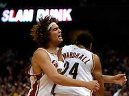 PHOTO BY DAVID RICHARD.Anderson Varejao, left, celebrates with teammate Donyell Marshall after Marshall took a pass from LeBron James to the rim for a dunk April, 1 2006 at Quicken Loans Arena.