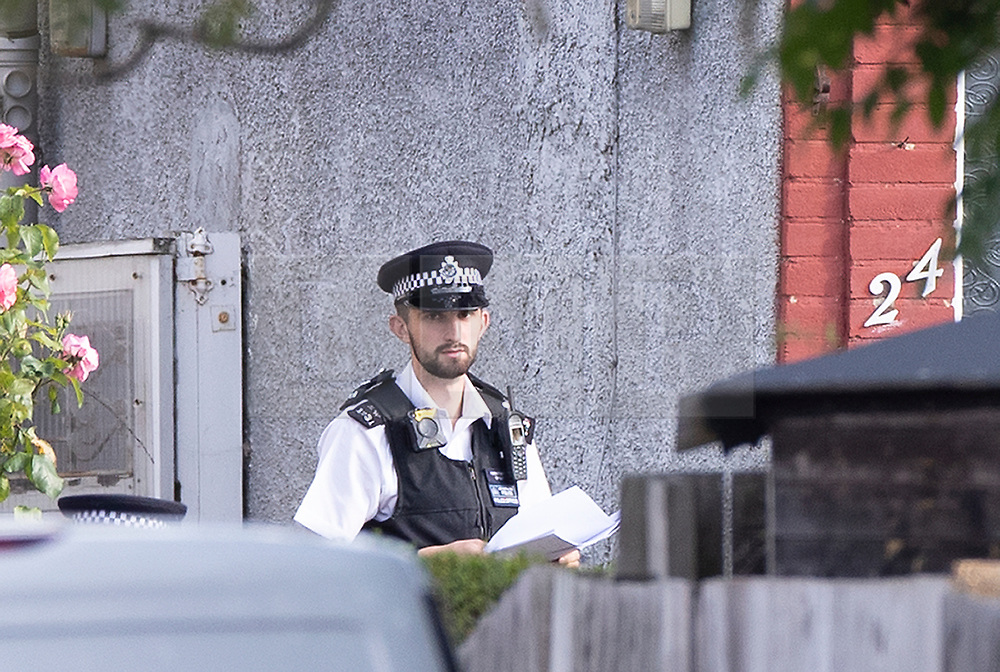 © Licensed to London News Pictures. 12/07/2019. London, UK. A policeman stands guard outside an address in Redfern Avenue, Whitton, South West London where a man and a woman have been fatally stabbed. A 31-year-old man was arrested after a man, aged in his 60s, and a woman, aged in her 70s were found at the property with stab injuries. Photo credit: Peter Macdiarmid/LNP