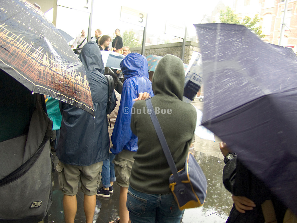 waiting in line during an heavy downpour