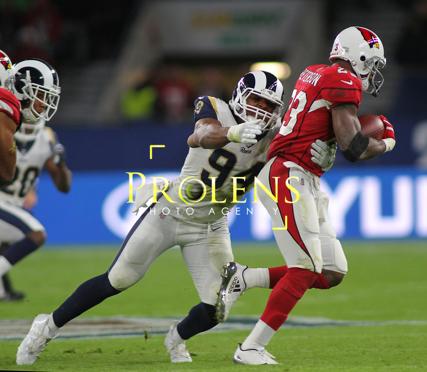 LONDON, ENGLAND - OCTOBER 22: Los Angeles Rams outside linebacker Robert Quinn (94) tackles Arizona Cardinals running back Adrian Peterson (23) during the NFL match between the Arizona Cardinals and the Los Angeles Rams at Twickenham Stadium on October 22, 2017 in London, United Kingdom. (Photo by Mitchell Gunn/ESPA-Images)