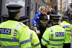 © Licensed to London News Pictures. 21/11/2020. Liverpool, UK. Police officers speak to a protester during an anti-lockdown protest in Liverpool. Thousands of anti-lockdown protesters took to the streets across the country against lockdown . Photo credit: Ioannis Alexopoulos/LNP