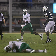 Marshall quarterback Rakeem Cato (12) eludes Central Florida defensive lineman Victor Gray (91) as Marshall wide receiver Jermaine Kelson (18) lays injured during an NCAA football game between the Marshall Thundering Herd and the Central Florida Knights at Bright House Networks Stadium on Saturday, October 8, 2011 in Orlando, Florida. (Photo/Alex Menendez)