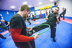 Students kicking the area of the hoop, Stef Noij, KMG Instructor from the Institute Krav Maga Netherlands, at the IKMS G Level Programme seminar today at the Scottish Martial Arts Centre, Alloa.