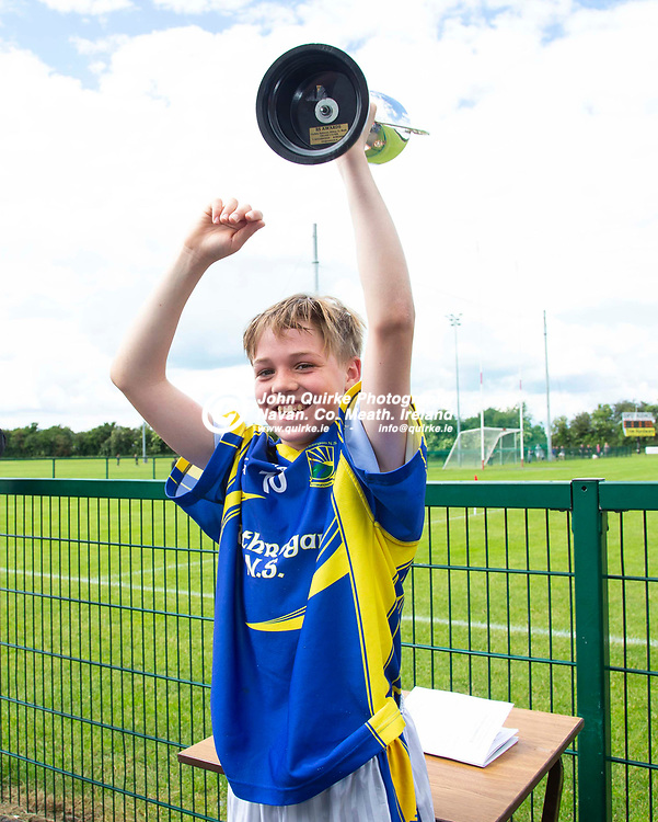 15/06/2019, Game 6: Division 4 Hurling Final, Rathmore NS vs Rathreggan NS<br /> Rathregan NS Captain, Sean O`Neill raises the cup after they defeated Rathmore NS in the Division 4 hurling final<br /> Photo: David Mullen / www.quirke.ie ©John Quirke Photography, Unit 17, Blackcastle Shopping Cte. Navan. Co. Meath. 046-9079044 / 087-2579454.<br /> ISO: 250; Shutter: 1/200; Aperture: 8; <br /> File Size: 2.3MB