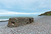 Gun Turret emplacements from World War II coastal defence on Bossington Beach at Exmoor, Somerset, UK