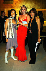 Left to right, PADMA LAKSHMI, JODIE KIDD and DONNA KARAN at a party to celebrate the first 20 years of fashion label Donna Karan held at her store at 19/20 New Bond Street, London W1 on 21st September 2004.<br />