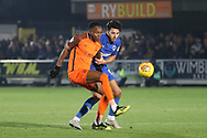 AFC Wimbledon defender Will Nightingale (5) battles for possession during the EFL Sky Bet League 1 match between AFC Wimbledon and Southend United at the Cherry Red Records Stadium, Kingston, England on 24 November 2018.