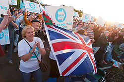 © Licensed to London News Pictures. 15/05/2019. Merthyr Tydfil, Powys, Wales, UK. There is a good turnout of 'Brexiteers' for the rally on a fine sunny evening. An outdoor Brexit Party rally takes place at Trago Mills in the Welsh, former mining town, of Merthyr Tydfil in Powys, UK. The Brexit Party was founded by former UKIP economics spokeswoman, Catherine Blaiklock in January 2019 to support the winning Brexit vote in the 'Leave or Remain' referendum of 23rd June 2016. Brexit Party members point out that the UK prime minister, Theresa May, has betrayed her electorate by not keeping her pledge that the UK would leave the European Union on March 29th 2019, the date set by invoking article 50 of the Treaty of Lisbon. Photo credit: Graham M. Lawrence/LNP