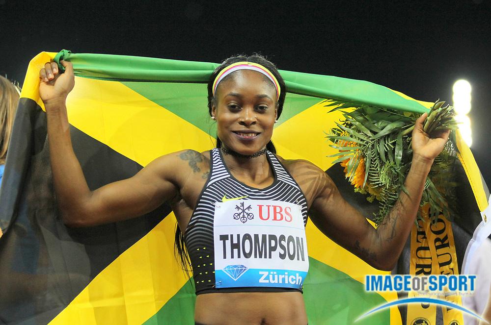 Sep 1, 2015; Zurich, SWITZERLAND; Elaine Thompson (JAM) poses with Jamaican flag after winning the women's 200m in 21.85 at the 2016 Weltklasse Zurich during an IAAF Diamond League meeting at Letzigrund Stadium. Photo by Jiro Mochizuki