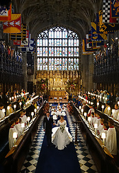 Princess Eugenie and Jack Brooksbank walks down the aisle of the Quire after they were married at St George's Chapel in Windsor Castle.