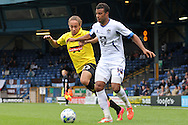 Bury's Tom Soares battles for the ball with Burton's Marcus Harness (l). Skybet football league two match, Bury v Burton Albion at the JD Stadium, Gigg Lane in Bury, Lancs on Saturday 20th Sept 2014.<br /> pic by David Richards,  Andrew Orchard sports photography.