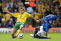 Photo: Daniel Hambury.<br /> Norwich City v Birmingham City.<br /> FA Barclays Premiership.<br /> 07/05/2005.<br /> Norwich's Adam Drury and Birmingham's Mario Melchiot go for the ball.