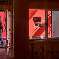 020915  Adron Gardner/Independent<br /> <br /> Gary Hallock walks out from a third floor Hooghan Hózhó apartment under construction in Gallup Monday.  The apartments are scheduled to be completed this summer.
