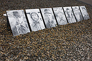 The faces of prisoners at the location where over 10,000 Soviet prisoners were shot in 1941 in the Nazi Sachsenhausen concentration camp during WW2, now known as the Sachsenhausen Memorial and Museum. Sachsenhausen was a Nazi and Soviet concentration camp in Oranienburg, 35 kilometres (22 miles) north of Berlin, Germany, used primarily for political prisoners from 1936 to the end of the Third Reich in May 1945. After World War II, when Oranienburg was in the Soviet Occupation Zone, the structure was used as an NKVD special camp until 1950. Executions took place at Sachsenhausen, especially of Soviet prisoners of war. 30,000 inmates died there from exhaustion, disease, malnutrition, pneumonia, etc. The remaining buildings and grounds are now open to the public as a museum.