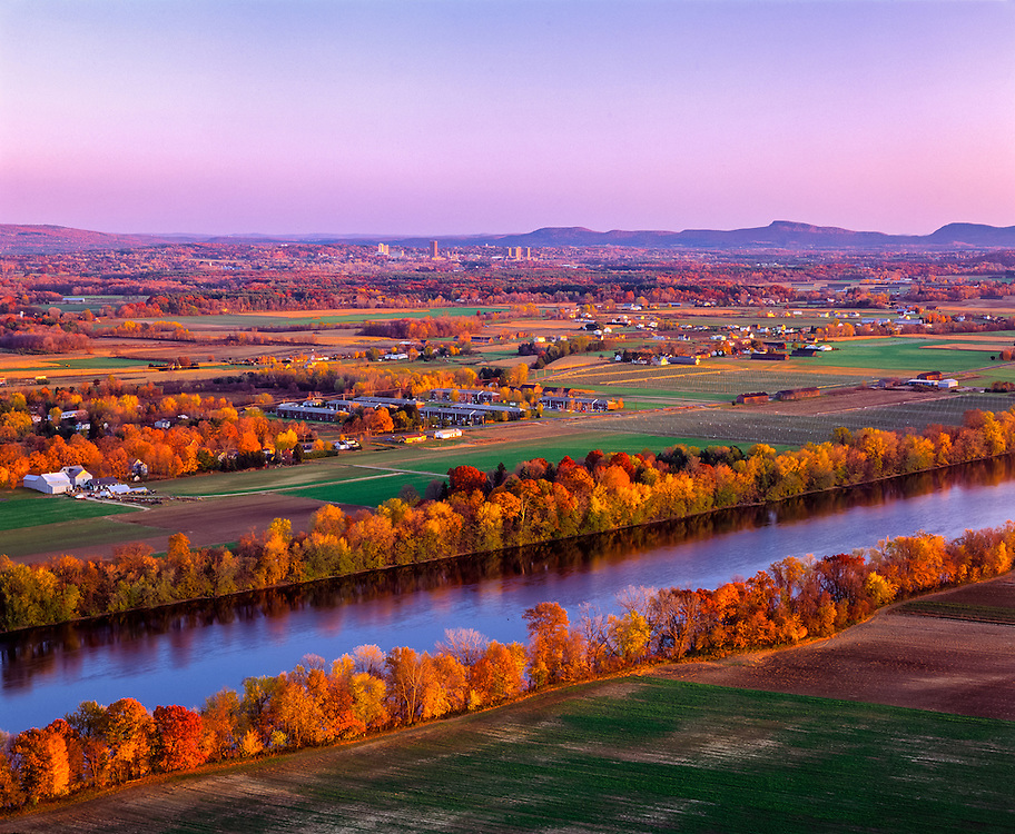 Connecticut River Valley view in fall, with fields, farms, village, distant mountain ridgelines, Sunderland, MA
