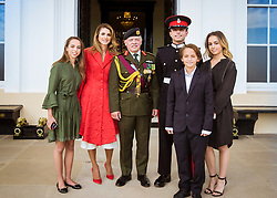 Queen Rania and King Abdullah of Jordan pose with their son, Crown Prince Hussein, who just graduated from Royal Military Academy Sandhurst (RMAS), known as Sandhurst, on August 11, 2017, in Camberley, south west of London, United Kingdom. Photo by Balkis Press/ABACAPRESS.COM