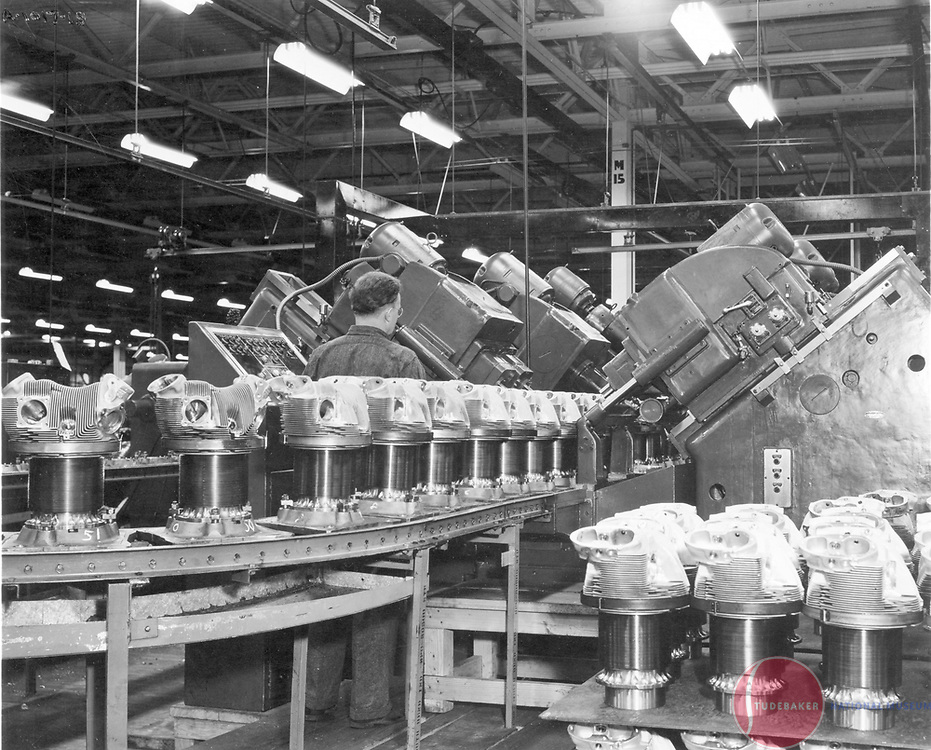A number of the final machining operations on the cylinder rhead and barrel assembly for Studebaker-built Cyclone engines are done on the special Greenlee machine. There are six workstations on this Greenlee and eight tools, two of them special tools, two taps and four drills. When in full operation this Greenlee will handle 17 head and barrel assemblies at one time.