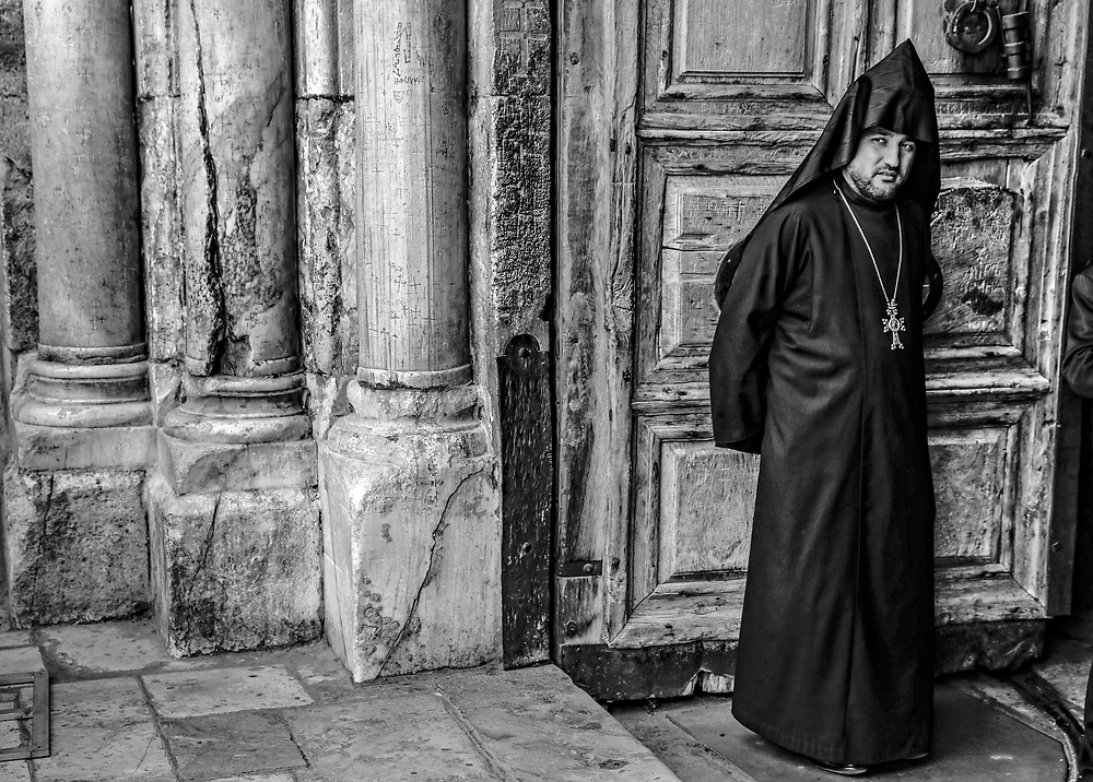 A member of the Orthodox Christian clergy outside the Church of the Holy Sepulchre in Jerusalem's Old City.