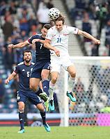 UEFA Euro 2020 Championship Group D match between Scotland v Czech Republic Hampden Park on June 14, 2021 in Glasgow, Scotland<br /> <br /> Alex Kral (Czech) out jumps John McGinn with Grant Hanley (Scotland) behind.<br /> <br /> Credit: COLORSPORT/Ian MacNicol