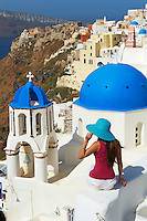 Greece, Cyclades, Santorini island, oia (Ia) village, church with blue dome, tourist