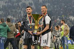 May 19, 2019 - Turin, Turin, Italy - Mattia Perin, Leonardo Bonucci Juventus FC lift the trophy of Scudetto  2018-2019 at Allianz Stadium, Turin  (Credit Image: © Antonio Polia/Pacific Press via ZUMA Wire)