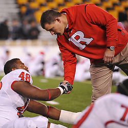 Oct 23, 2009; West Point, N.Y., USA; Rutgers head coach Greg Schiano shakes hands with defensive tackle Blair Bines (48) during warmups before Rutgers' 27 - 10 victory over Army at Michie Stadium.