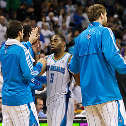 January 19, 2011; New Orleans, LA, USA; New Orleans Hornets guard Marcus Thornton (5) celebrates with teammates during the fourth quarter of a game against the Memphis Grizzlies at the New Orleans Arena. The Hornets defeated the Grizzlies 130-102 in overtime.  Mandatory Credit: Derick E. Hingle
