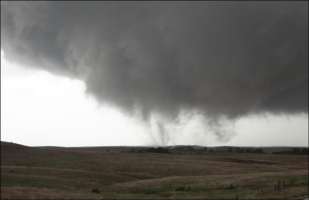 Wide forming tornado in an open field near Lincoln, Kansas.