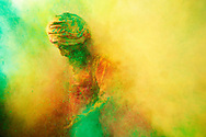 A Sadhu making his way out of the cloud of colors during the festival of Holi in India.