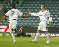 Photo: Aidan Ellis.<br /> Rochdale v Wycombe Wanderers. Coca Cola League 2. 16/09/2006.<br /> Wycombe's Kevin Betsy runs to congratulate Jonny Dixon after he scored the second goal