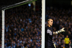 Barcelona Goalkeeper Victor Valdes (ESP) points - Photo mandatory by-line: Rogan Thomson/JMP - Tel: 07966 386802 - 18/02/2014 - SPORT - FOOTBALL - Etihad Stadium, Manchester - Manchester City v Barcelona - UEFA Champions League, Round of 16, First leg.
