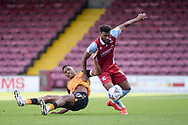 Myles Hippolyte (15) of Scunthorpe United Tristan Abrahams of Newport County battles for possession during the EFL Sky Bet League 2 match between Scunthorpe United and Newport County at Glanford Park, Scunthorpe, England on 12 September 2020.