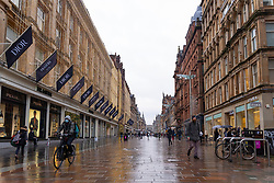 Glasgow, Scotland, UK. 11 December 2020. Covid-19 lockdown level 4 restrictions are lifted in Glasgow. Non essential businesses such as shops and restaurants can reopen from today. Pictured ; Buchanan Street was quiet early on Friday but got busier in the afternoon.   Iain Masterton/Alamy Live News