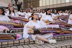 October 4, 2018 - Hong Kong, CHINA - Hundred of young students perform traditional music piece outdoor on Chinese harps as part of China national day celebration in Hong Kong. Oct-4,2018 Hong Kong.ZUMA/Liau Chung-ren (Credit Image: © Liau Chung-ren/ZUMA Wire)