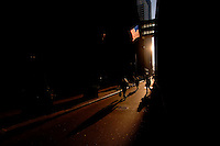Pedestrians walk across William Street in Lower Manhattan to start the workday the morning of Tuesday, January 24, 2006.