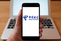 Using iPhone smartphone to display logo of China Telecom the Chinese state-owned telecommunication company