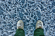 Bunny boots on spring ice in the Yukon while ice fishing.