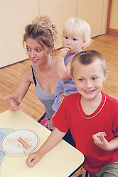 Mother with two young children at surviving homelessness project,