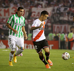 10.12.2014, River Plate Stadium, Buenos Aires, ARG, Südamerika Cup 2014, River Plate vs Atletico Nacional de Medellin, im Bild River Plate football player Sebastina Druissi (r) versus Alejandro Bernal (r) from Atletico Nacional de Medellin, Colombia // during the 2nd final match of Southamerican Cup between River Plate vs Atletico Nacional and Medellin at the River Plate Stadium in Buenos Aires, Argentina on 2014/12/10. EXPA Pictures © 2014, PhotoCredit: EXPA/ Eibner-Pressefoto/ Cezaro<br /> <br /> *****ATTENTION - OUT of GER*****