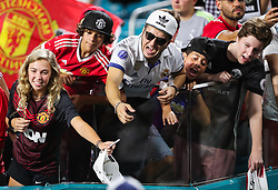 July 31, 2018 - Miami Gardens, Florida, USA - Fans scream to get autographs from players leaving the field at the end of an International Champions Cup match between Real Madrid C.F. and Manchester United F.C. at the Hard Rock Stadium in Miami Gardens, Florida. Manchester United F.C. won the game 2-1. (Credit Image: © Mario Houben via ZUMA Wire)