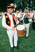 Traditional English Morris Men in costume with floral hats at a Morris dancing festival in Cambridge, UK