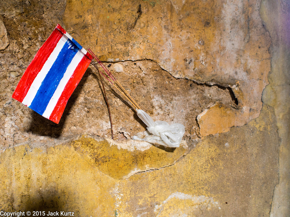 17 MARCH 2015 - BANGKOK, THAILAND: A hand drawn Thai flag hanging on interior hallway in the old Customs House in Bangkok. The old Customs House was once the financial gateway to Thailand (before 1932 called Siam). It was designed by an Italian architect in the 1880s. In the 1950s, customs moved to new, more modern building and the Customs House became the headquarters for the Marine firefighters. The firefighters now live in the decrepit buildings with their families.    PHOTO BY JACK KURTZ