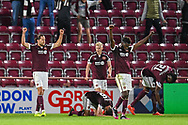 The Hearts players celebrate after the final whistle of the Cinch SPFL Premiership match between Heart of Midlothian FC and Celtic FC at Tynecastle Park, Edinburgh, Scotland on 31 July 2021.