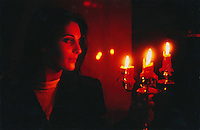 Beautiful woman in candlelight