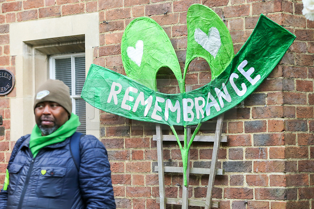 © Licensed to London News Pictures. 14/06/2019. London, UK. A friends of the victim outside St Helen's Church to commemorate the second anniversary of the Grenfell Tower fire service. On 14 June 2017, just before 1:00am a fire broke out in the kitchen of the fourth floor flat at the 24-storey residential tower block in North Kensington, West London, which took the lives of 72 people. More than 70 others were injured and 223 people escaped. Photo credit: Dinendra Haria/LNP