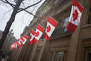 "Canadian flags hang outside Canade House in London's Trafalgar Square, Westminster. Canada House (Maison du Canada) is a Greek Revival building on Trafalgar Square in London that is part of the High Commission of Canada in London. Canada House hosts the cultural and consular sections of the High Commission. Canada House is very much a public building. It contains the High Commissioner's office, and hosts conferences, receptions, lectures, lunches and ""vernissages"" where Canadians and Britons can meet, and has facilities for film, video and television screenings."